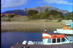 Boat dock, mountains, in Andes, Lake Nahuel Huapí Stock Footage