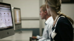 Two students in computer room Stock Footage