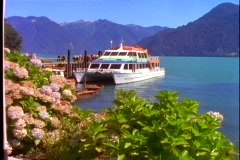 Boat on lake in Chile, Andes mountain lake, ready to depart, wide shot Stock Footage