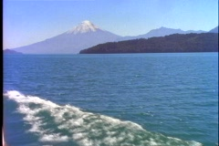 Crossing Andes mountain lake, Chile, POV from boat, Osorno Volcano Stock Footage
