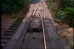 Santiago, Chile, funicular up hill to Virgin statue, POV of tracks, pass other Stock Footage
