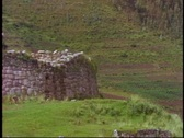 Stock Video Footage of Peru, The Andes, Inca ruins on hillside, close up, zoom out wide, no people