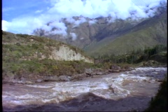 Peru, The Andes, train ride through Andes on narrow gauge, POV, raging river Stock Footage
