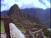 Stock Video Footage of Machu Picchu, Peru, The Andes, wide shot, classic view, pan right and down