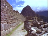 Stock Video Footage of Machu Picchu, Peru, The Andes, classic view, pan left to wall, medium wide