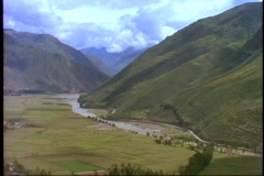 Peru, The Andes, wide shot of green mountains and river valley, excellent, still Stock Footage
