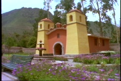 Peru, The Andes, small yellow Spanish church with twin bell towers Stock Footage