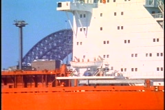 Sydney Harbor Bridge, close up of bridge detail with freighter in foreground, Stock Footage