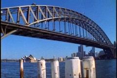Sydney Harbor Bridge, wide shot, with mooring posts Stock Footage