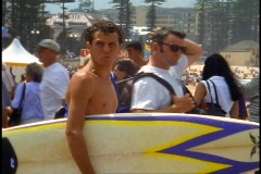 Sydney, Manly Beach resort, close up surfer holding board Stock Footage