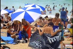 Sydney, Manly Beach resort, crowd, medium shot on beach, umbrella Stock Footage