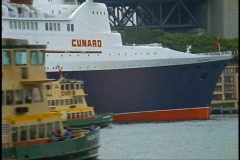 The Queen Elizabeth 2, QE2 close up Cunard Logo with three ferry boats Stock Footage