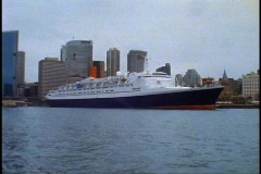 The Queen Elizabeth 2, QE2 approaching head on from ferry boat, POV, wide shot Stock Footage