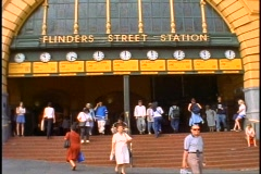 Melbourne, Flinders Street Railroad Station clocks, people under the arch Stock Footage
