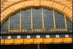 Melbourne, Flinders Street Railroad Station clocks, medium shot under the arch Stock Footage