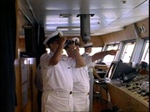 The Queen Elizabeth 2, QE2, The Bridge, Captain and Staff Captain, medium shot Stock Footage