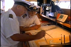 The Queen Elizabeth 2, QE2, The Bridge, Staff Captain and Captain with charts - stock footage