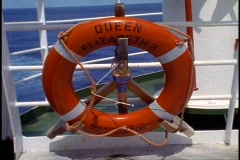 The Queen Elizabeth 2, QE2 ring buoy on rail, medium close up Stock Footage