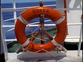 Stock Video Footage of The Queen Elizabeth 2, QE2 ring buoy on rail, medium close up