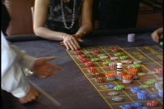 The Queen Elizabeth 2, QE2, Casino, roulette wheel, wide shot, board and chips Stock Footage