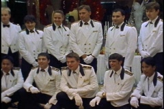 The Queen Elizabeth 2, QE2, waiters/stewards posing for group photo Stock Footage