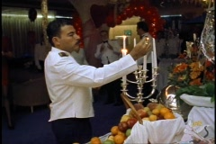 The Queen Elizabeth 2, QE2, stewards/waiters lighting candles on buffet display Stock Footage