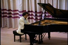 Stock Video Footage of The Queen Elizabeth 2, QE2, concert pianist playing in the theatre