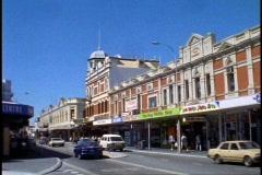 Fremantle Australia, Main Street, Victorian buildings, people, traffic, wide Stock Footage