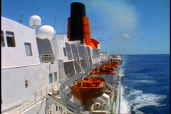 Queen Elizabeth 2, side shot of QE2 from bridge wings, pan right - stock footage