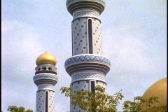 Brunei, Jame' Asr Hassanil Bolkiah Mosque, two minarets, tilt up - stock footage