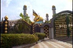 Brunei, Jame' Asr Hassanil Bolkiah Mosque, wide shot with gates and flags - stock footage
