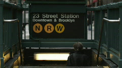 Rear view of person descending subway station steps at Manhattan Stock Footage