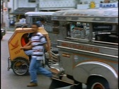 Stock Video Footage of Manila, pedal cart, medium shot into traffic with Jeepney