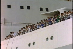 The Queen Elizabeth 2, QE2, bow rail side shot with lots of people on deck Stock Footage