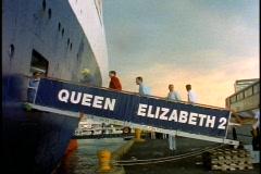 The Queen Elizabeth 2, QE2 gangway, people boarding, medium wide shot Stock Footage