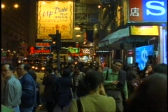 Hong Kong night street scene, medium shot with people, Nathan Road Stock Footage