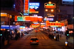Hong Kong by Night, neon lights, POV top of bus, bouncy ride up Nathan Road Stock Footage