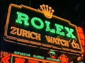 Stock Video Footage of Hong Kong by Night, neon lights, close-up Rolex Zurich Watch Company sign