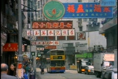 Hong Kong, buses, signs in Chinese, crowd, medium shot Stock Footage