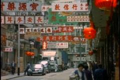 Hong Kong, signs in Chinese, medium wide shot, people in street Stock Footage