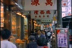 Hong Kong food market stall, medium shot, Chinese signs Stock Footage