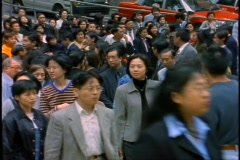 Hong Kong, Crowds of people during lunch hour on street medium wide shot Stock Footage