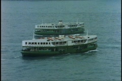 Hong Kong, Star Ferries cross, medium close-up, zoom out medium shot Stock Footage