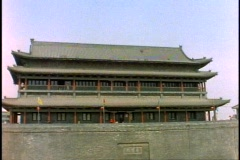 Stock Video Footage of China, Xian, City Wall, ancient building atop, wide shot