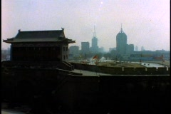 Stock Video Footage of China, Xian, City Wall and ancient building, city in background, wide shot,
