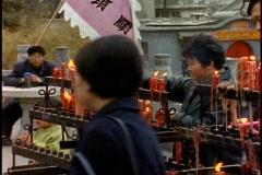 China, Xian, people lighting joss sticks at temple and praying Stock Footage