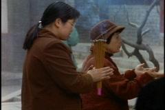 China, Xian, people lighting joss sticks at Buddhist Temple and praying Stock Footage