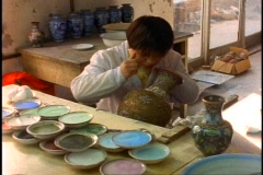 China, Cloisonné making, medium wide shot young girl Stock Footage