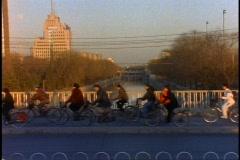 China, Beijing, bicycles riders, medium shot - stock footage