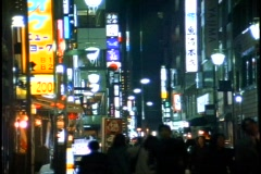 Tokyo, The Ginza District at night, neon lights, pedestrian mall Stock Footage
